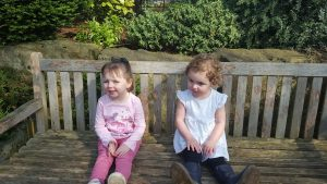 Jess and Molly sitting on a bench